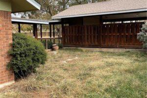 1701 Oak Street in Burnet TX backyard and attached carport