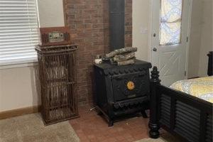 1701 Oak Street in Burnet TX bedroom with wood-burning stove