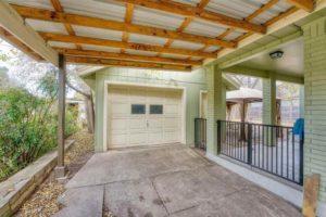 206 E Post Oak St in Burnet, TX covered garage driveway