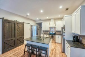 206 E Post Oak St in Burnet, TX remodeled kitchen with barn doors