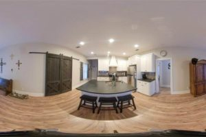 206 E Post Oak St in Burnet, TX panorama of kitchen and dining room