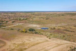 9018 N FM 1174 300 acres of land for sale in Burnet, TX with pond and road access